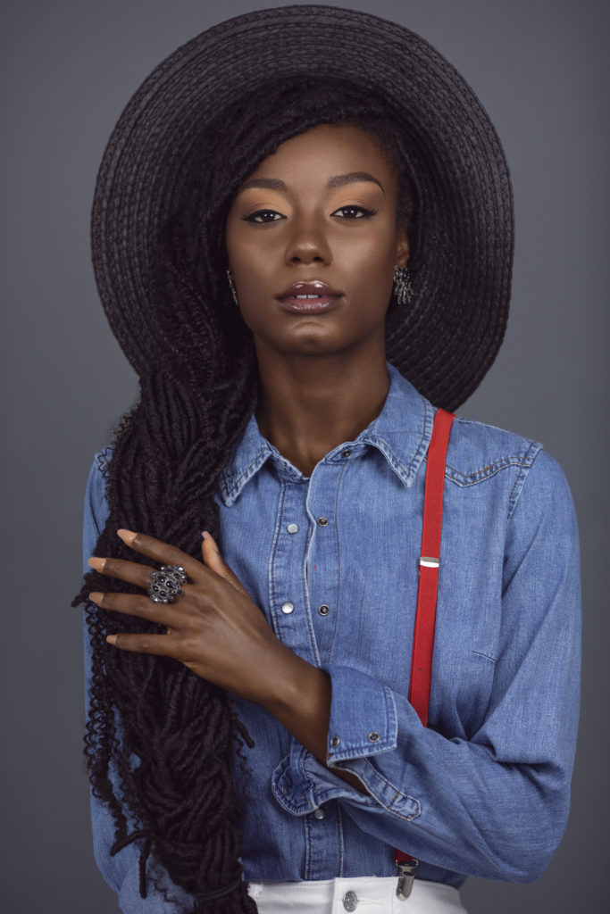 Sensual Black Lady With Red Suspenders