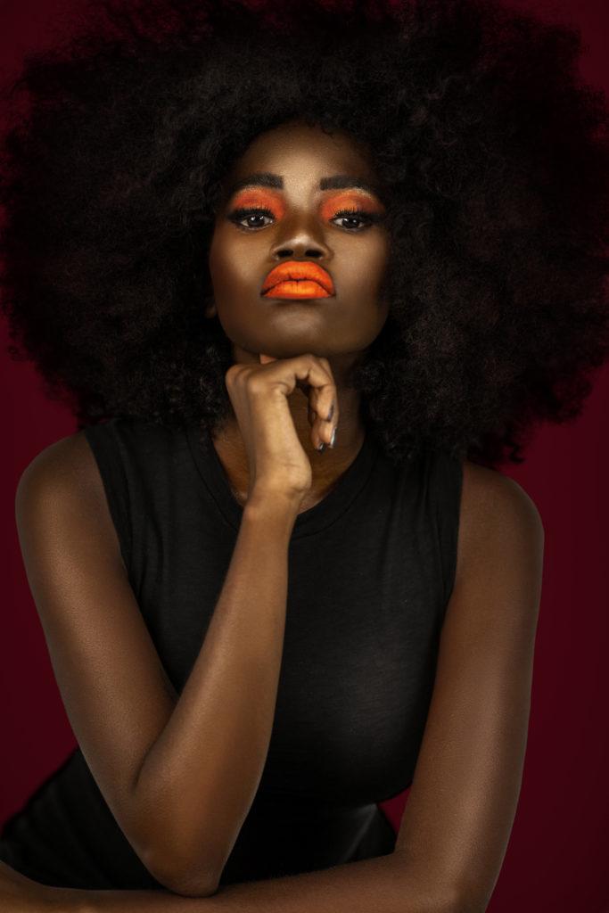 Clean & Serene Black Lady With Big Afro & Orange Lips