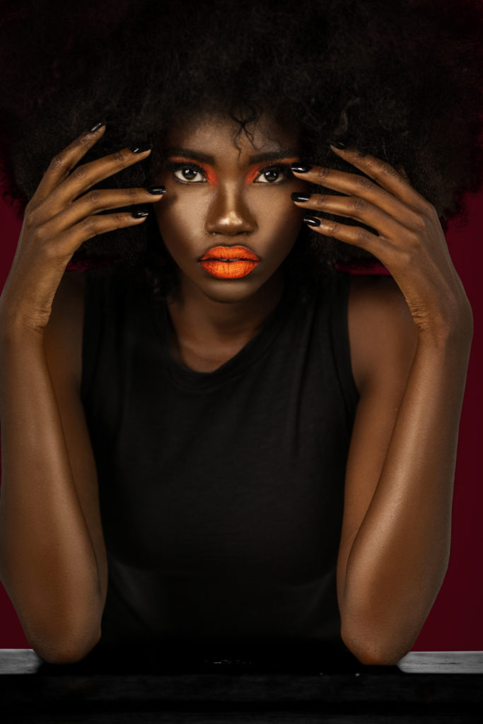 Clean & Serene Black Lady With Big Afro & Black Nails