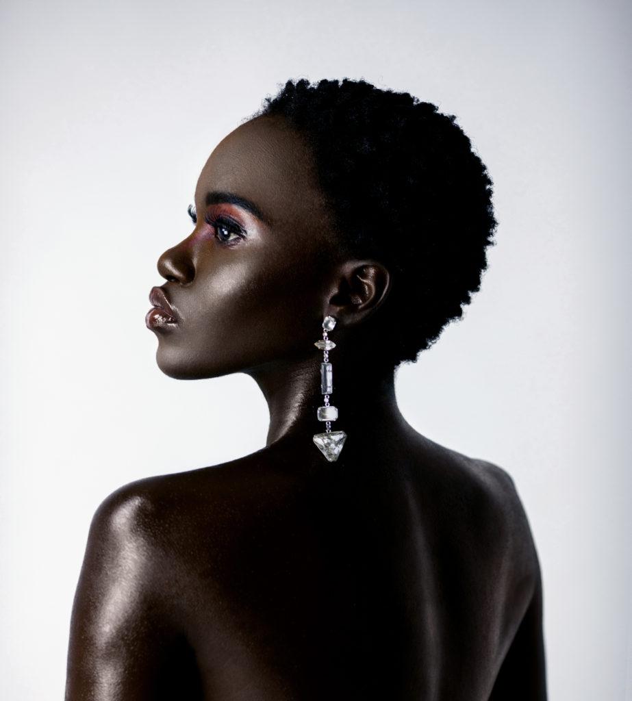 Closeup Clean & Serene Bare Back Black Lady With Diamond Earring