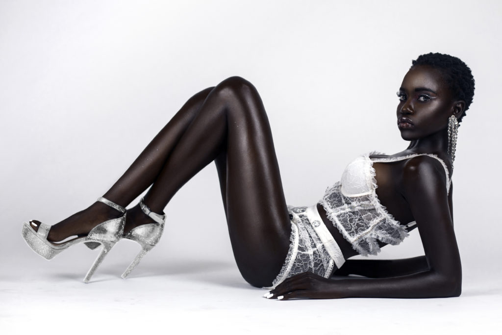 Short Hair Black Lady In White Laying On Floor