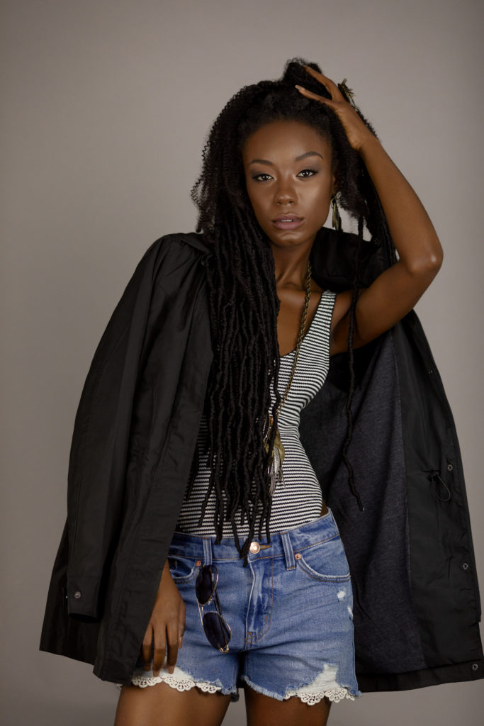 Young Black Lady in Dreads