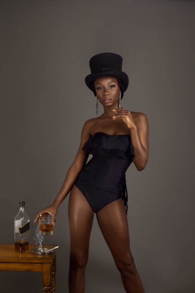 Whiskey Drinking Sexy Black Lady With Top Hat