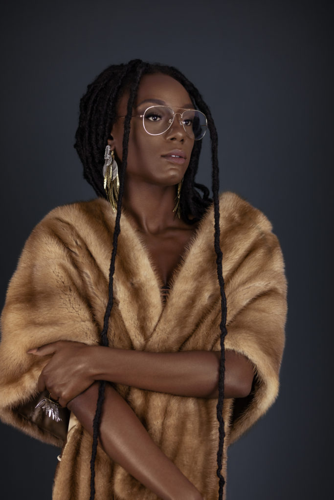 Serene Young Black Lady in Fur