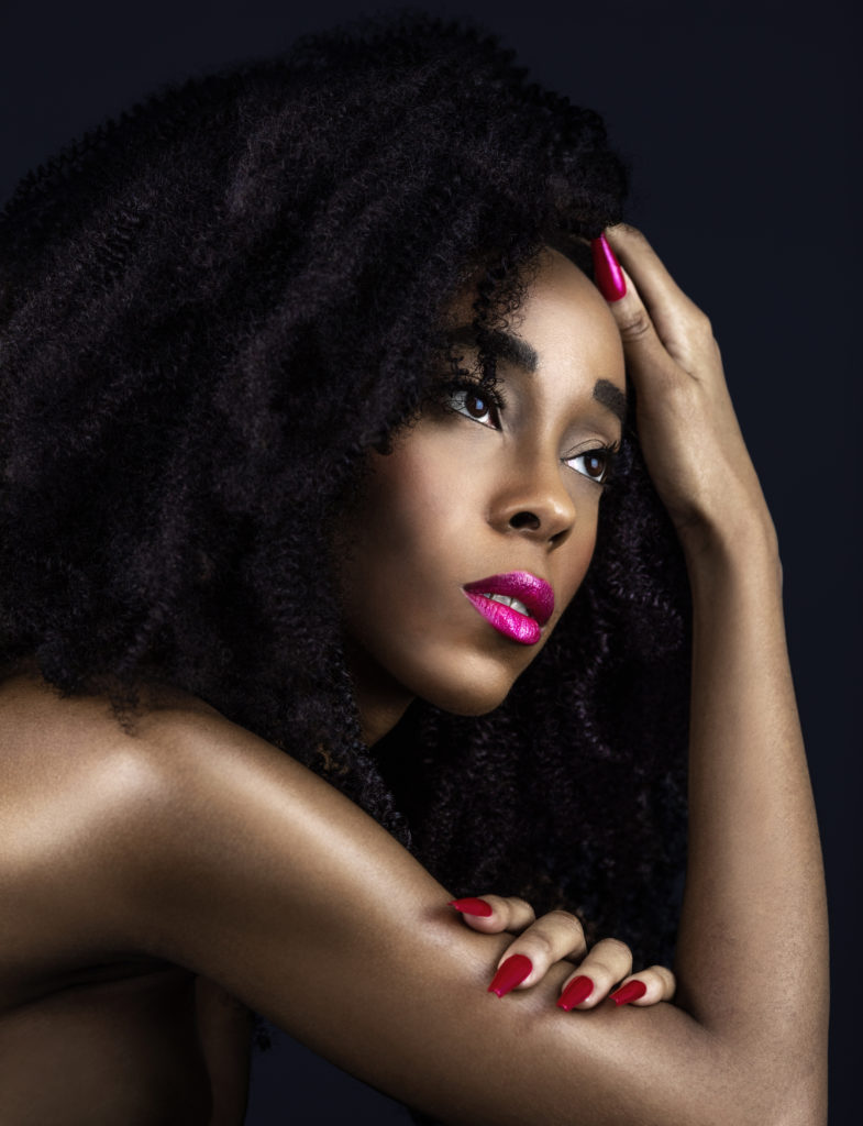 Curly Sensual Black Lady with Fuchsia Lipstick & Nails