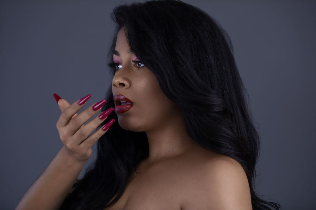 Curly Sensual Latina with Red Lipstick & Nails