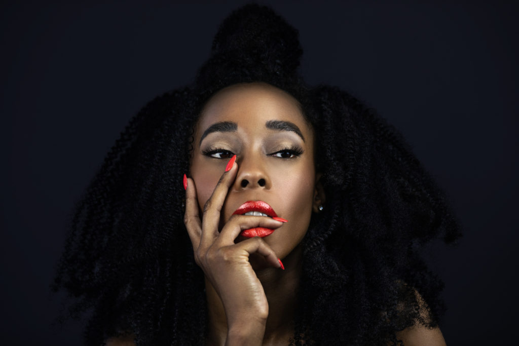 Curly Serene Black Lady with Red Lipstick & Nails