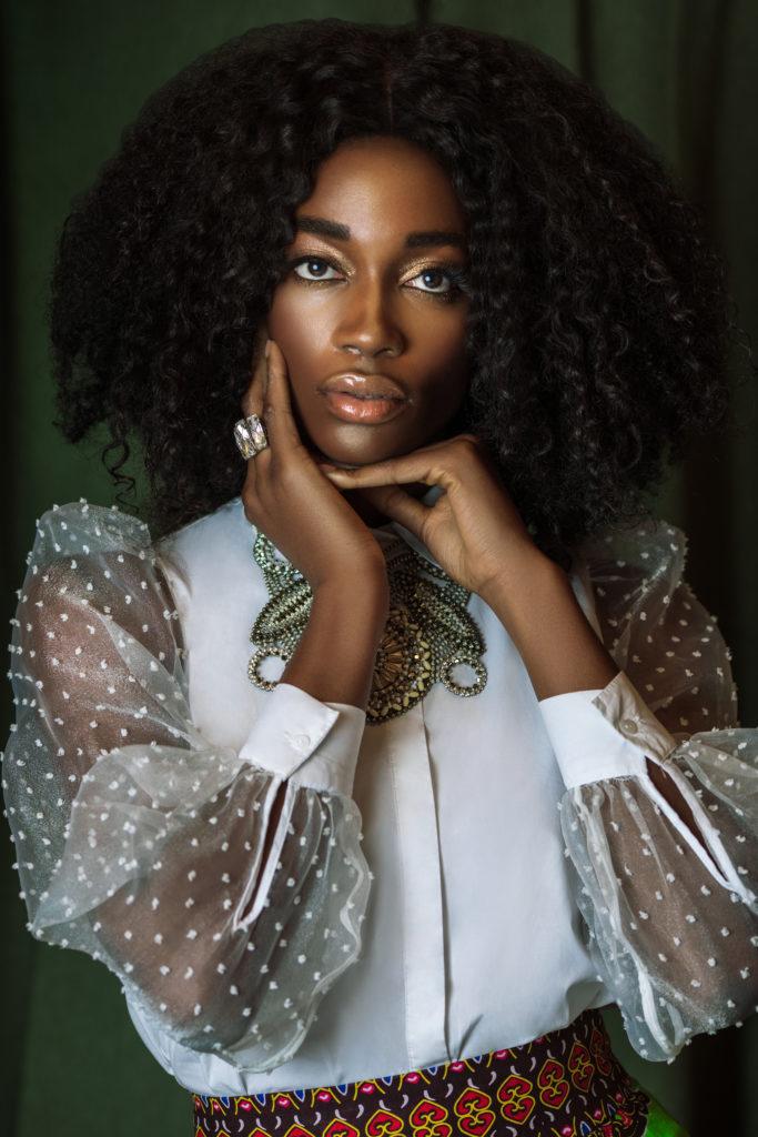 Elegant Black Lady in Sheer White Blouse