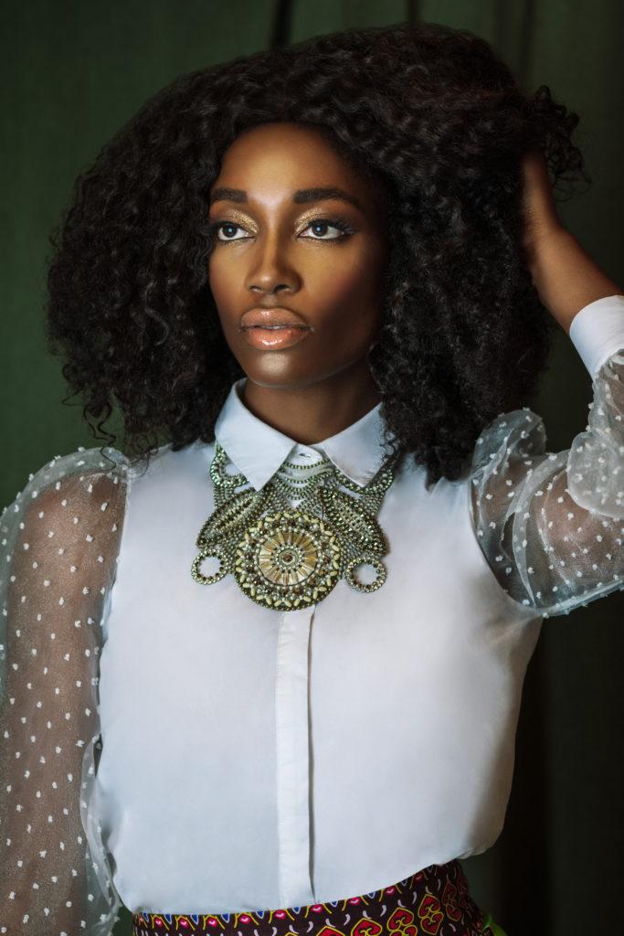 Serene Black Lady in Sheer White Blouse