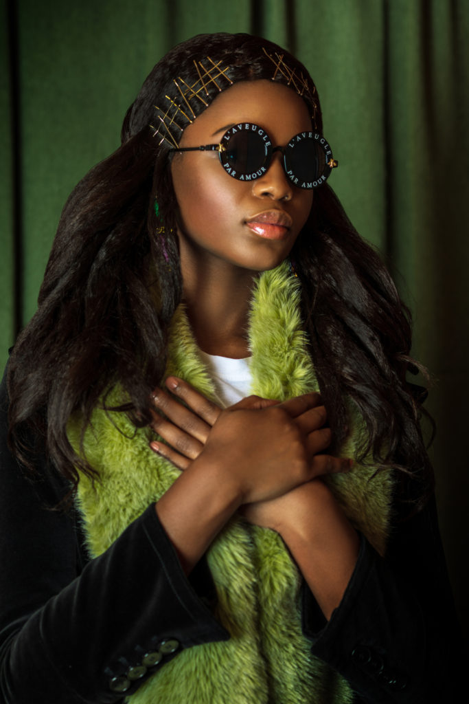 Serene Black Lady with Green Fur Coat