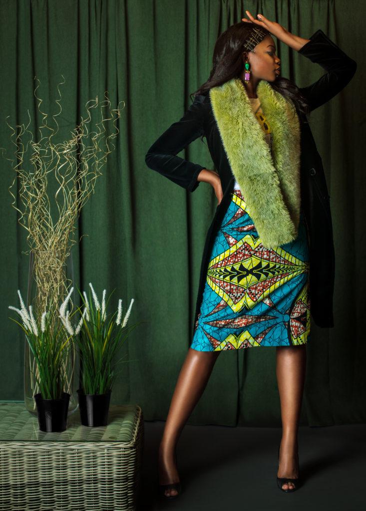 Elegant Black Lady with Green Fur Coat