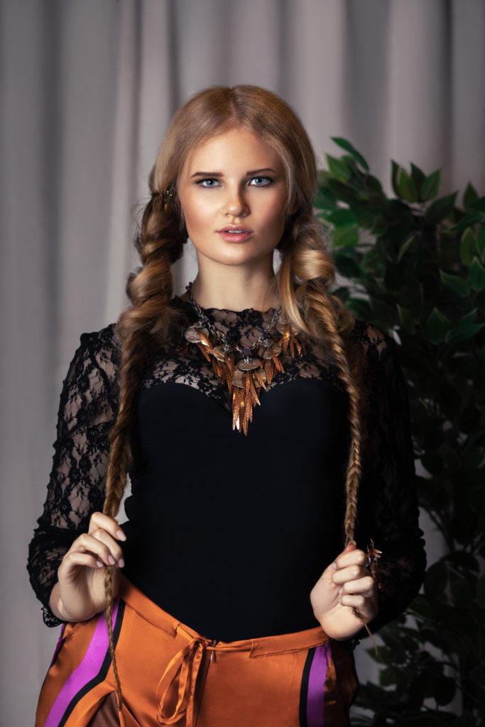 Sensual Blond Woman in Designer Clothing