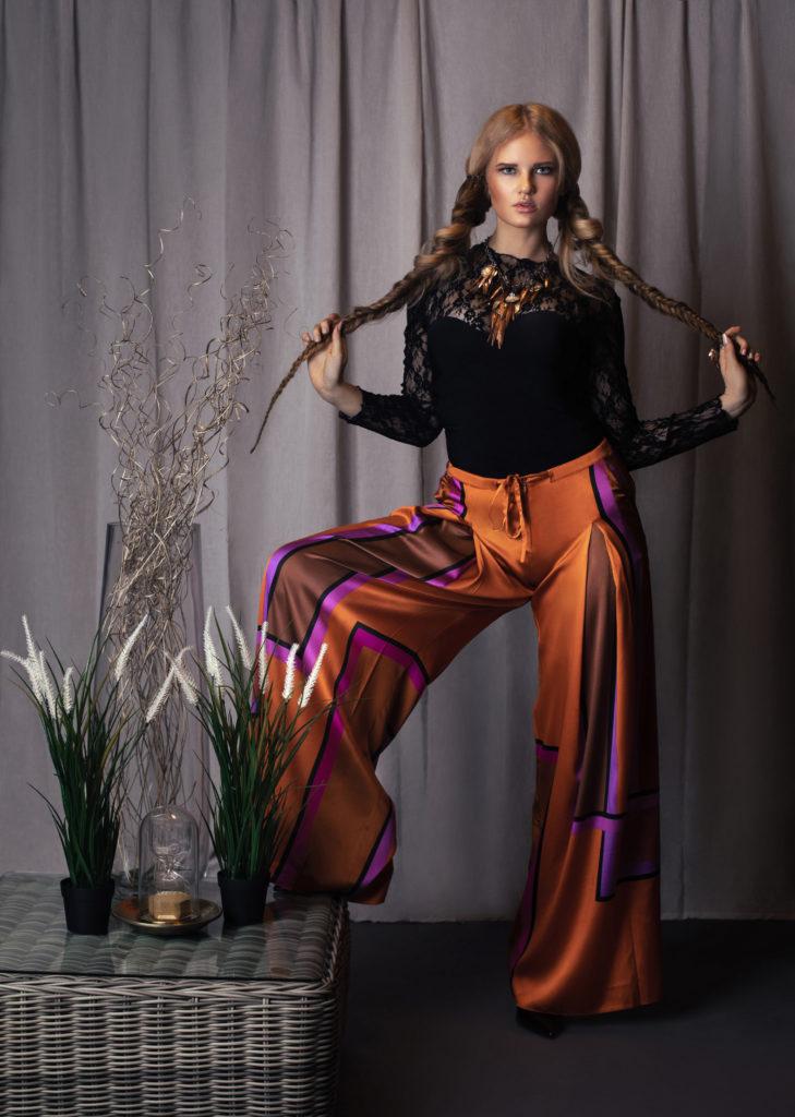 Rebel Blond Woman in Designer Clothing