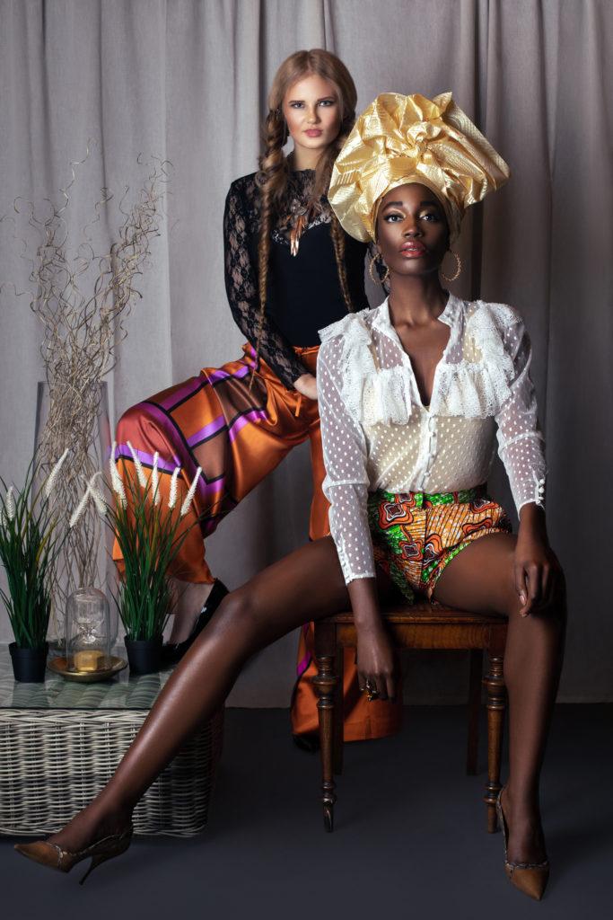 2 Beautiful Women in Designer Clothing