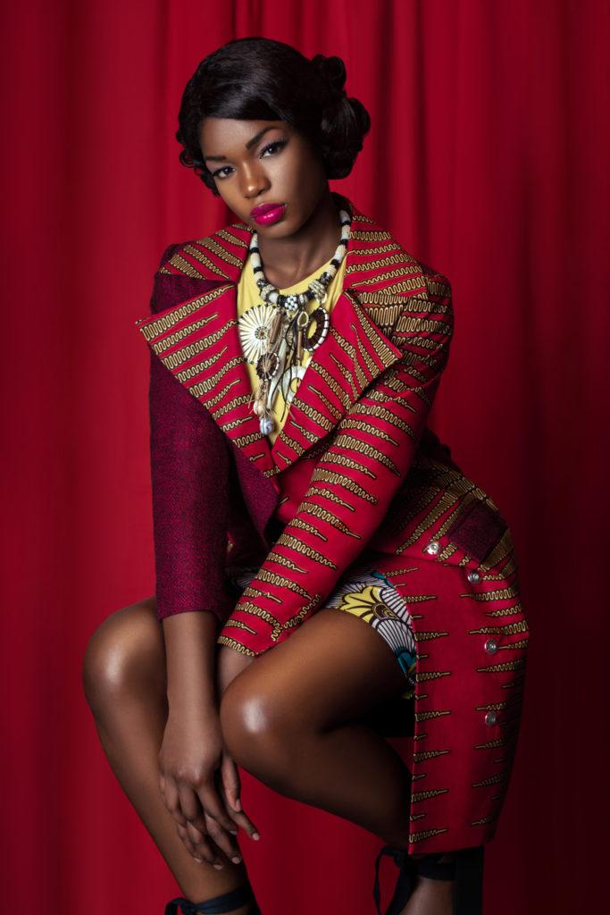 Elegant Black Lady with Red Coat