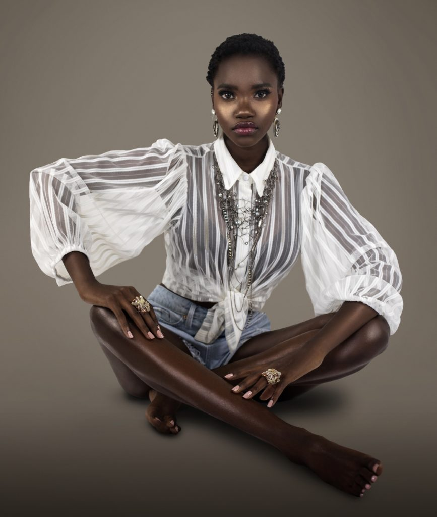 Clean & Serene Black Lady Sitting On Floor