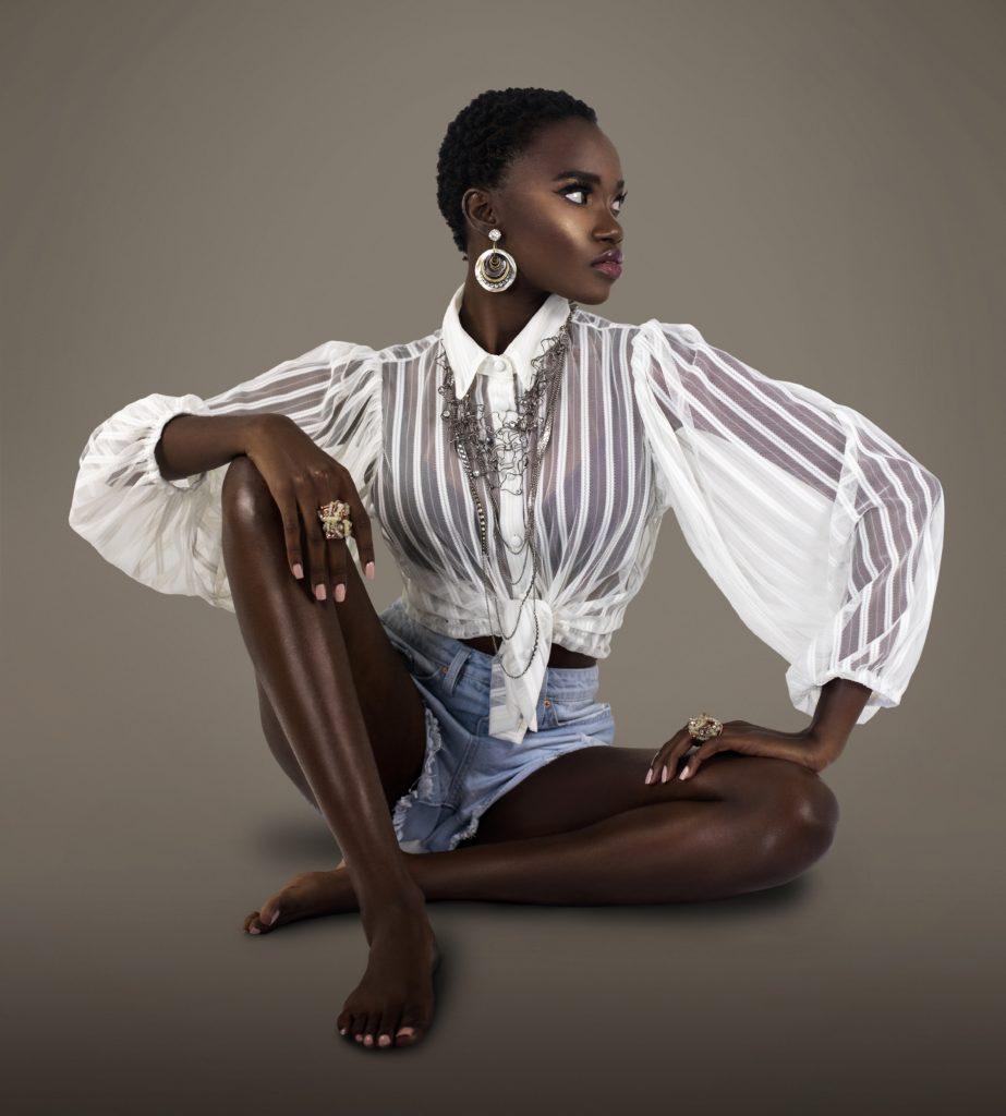 Short Hair Black Lady Sitting On Floor