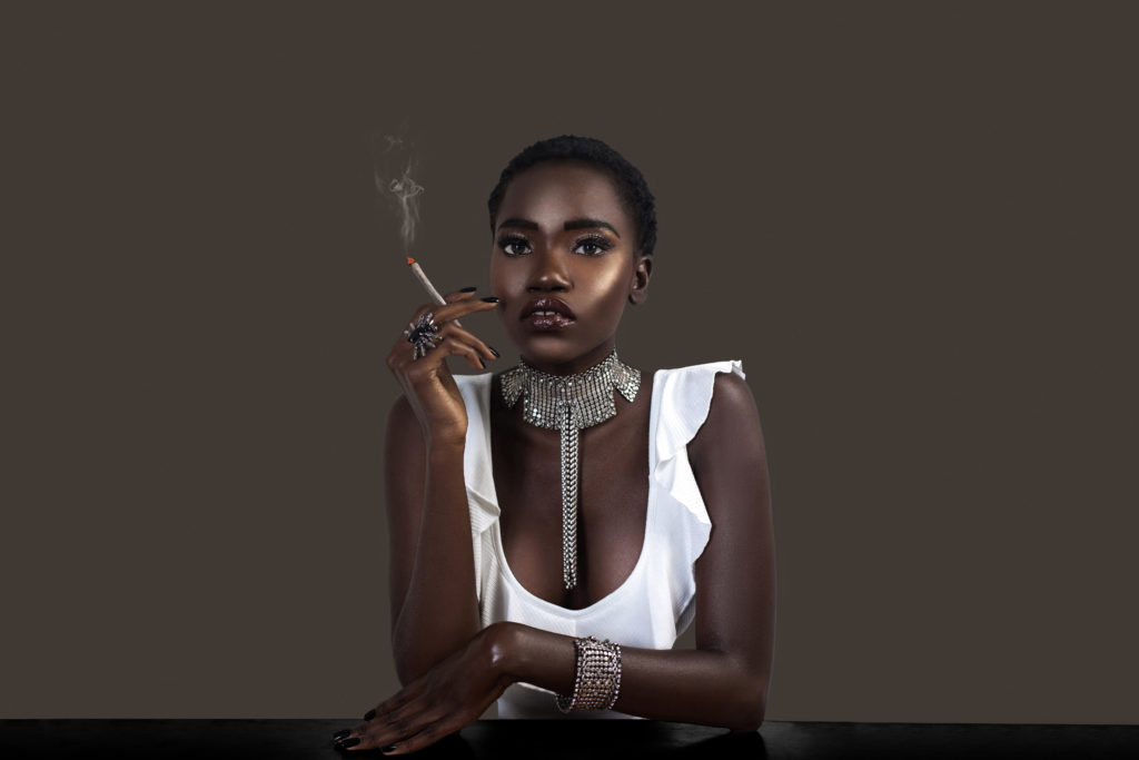 Joint Smoking Sensual Black Lady in Silver Jewelry