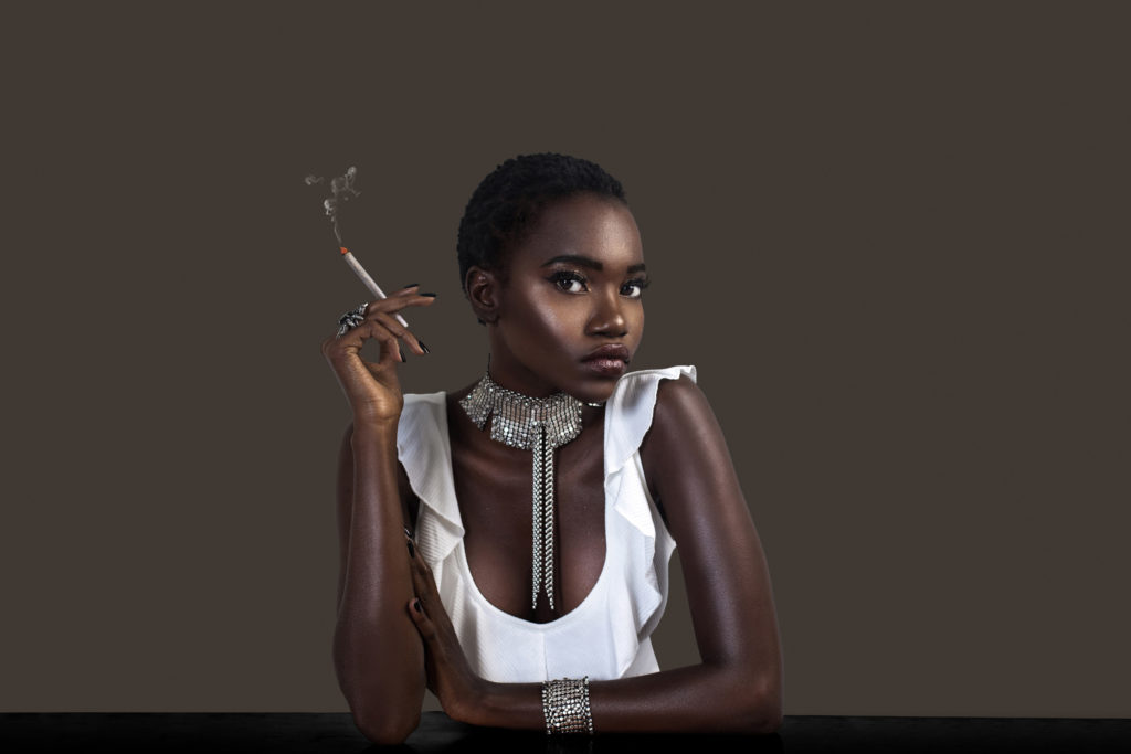 Joint Smoking Sexy Black Lady in Silver Jewelry