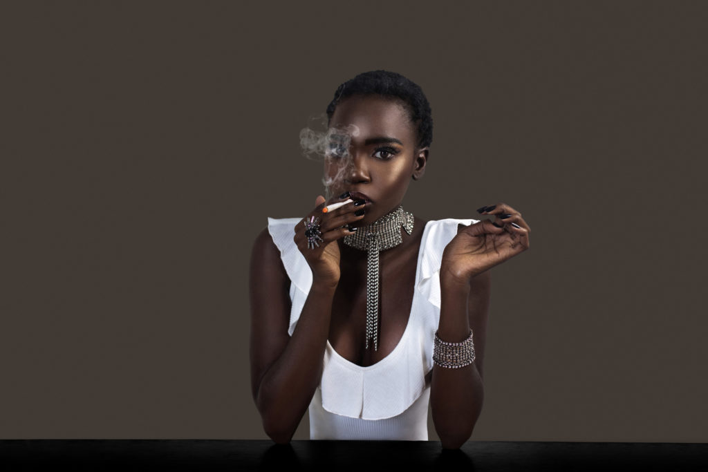 Joint Smoking Beautiful Black Lady in Silver Jewelry