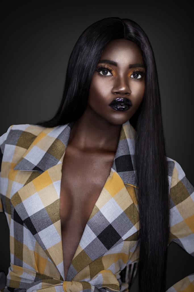 Clean & Serene Black Lady In Colorful Coat