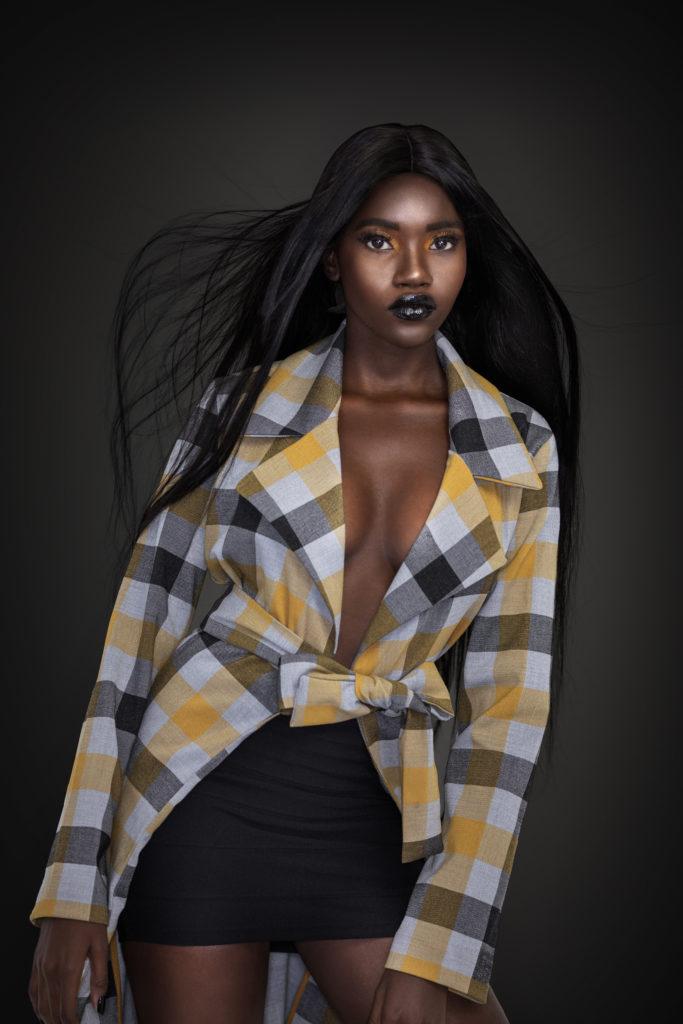 Clean & Serene Black Lady In Colorful Coat & Skirt