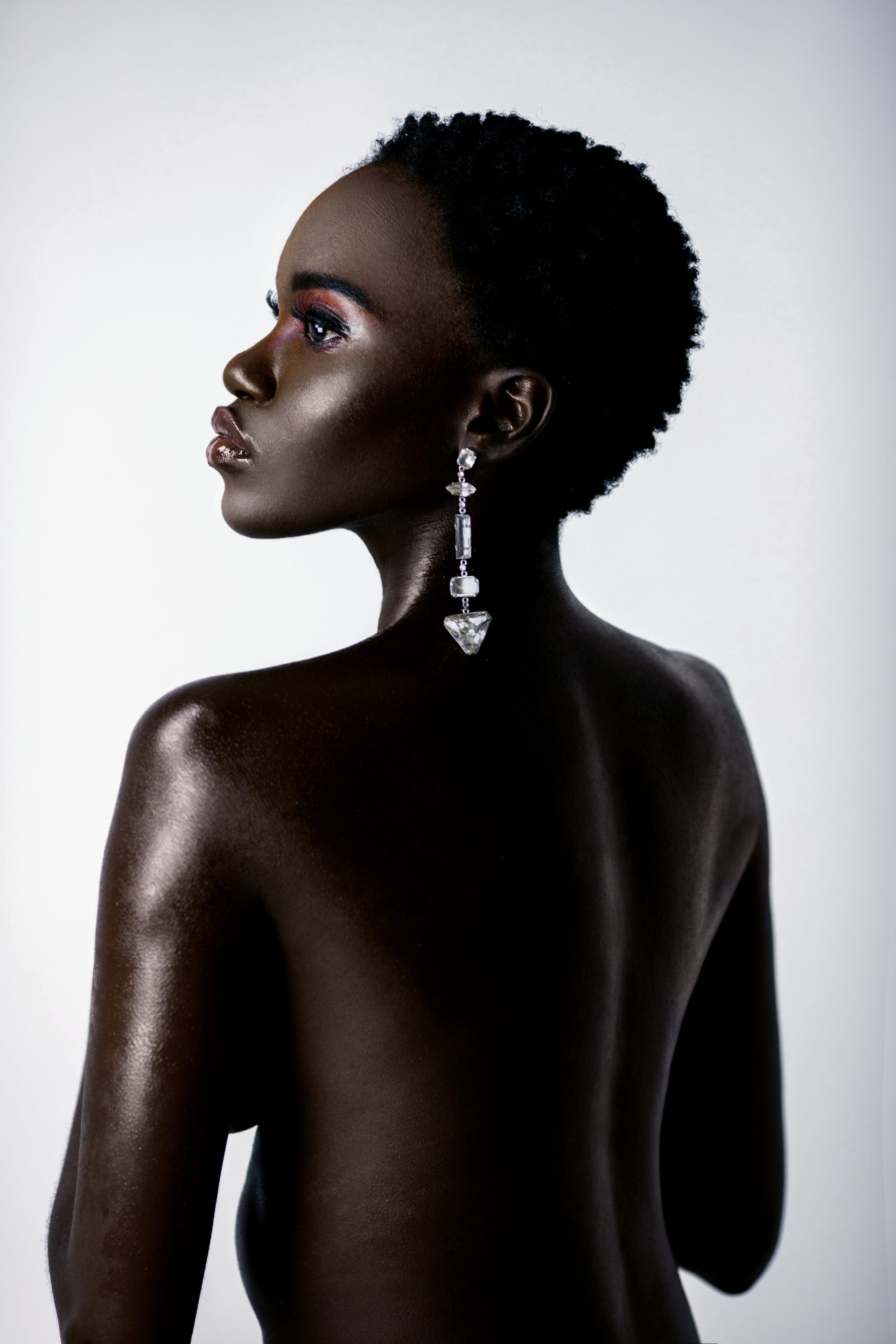Clean & Serene Bare Back Black Lady With Diamond Earring