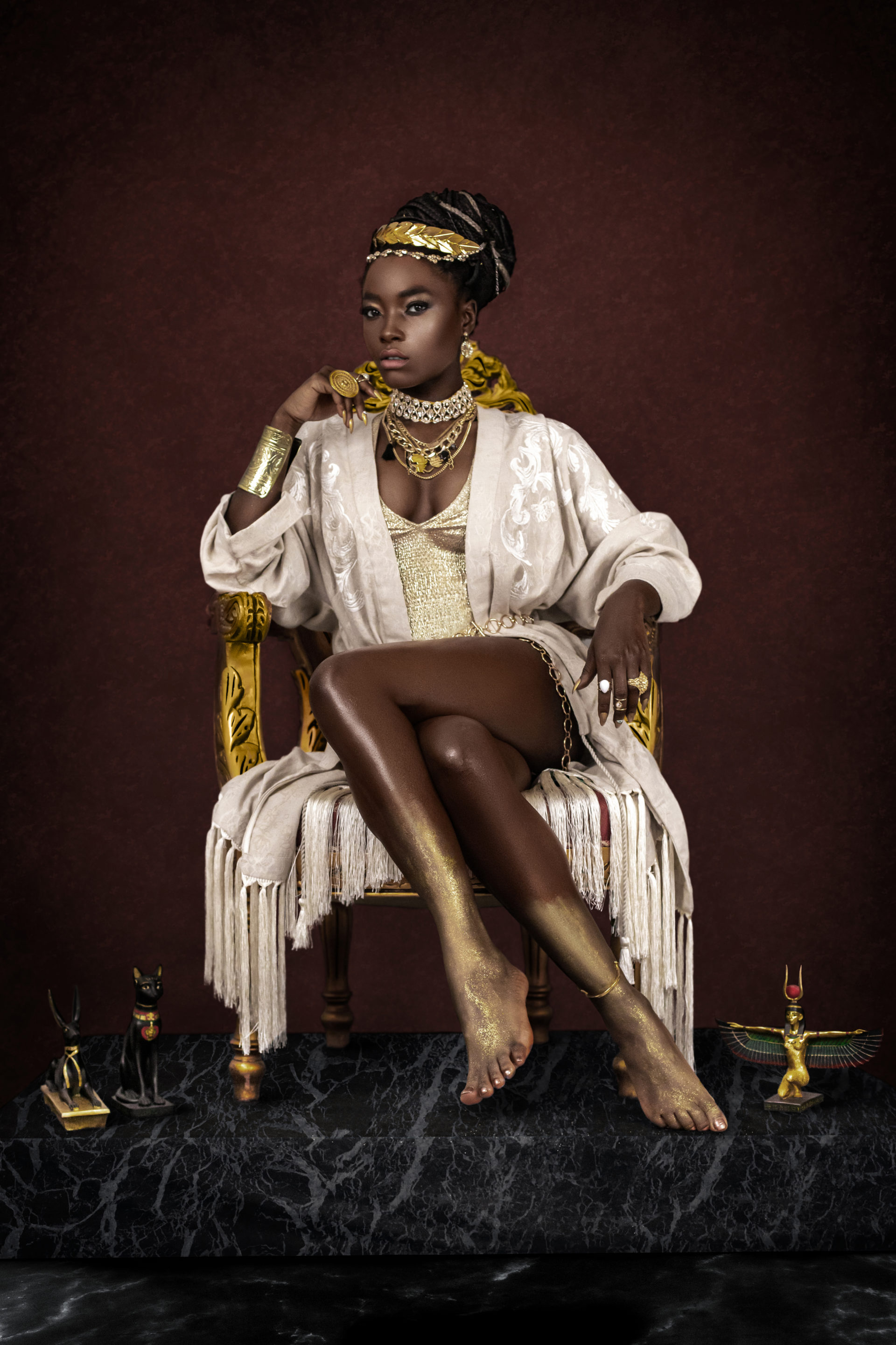 Female Egyptian Pharaoh Sitting On Gold Throne