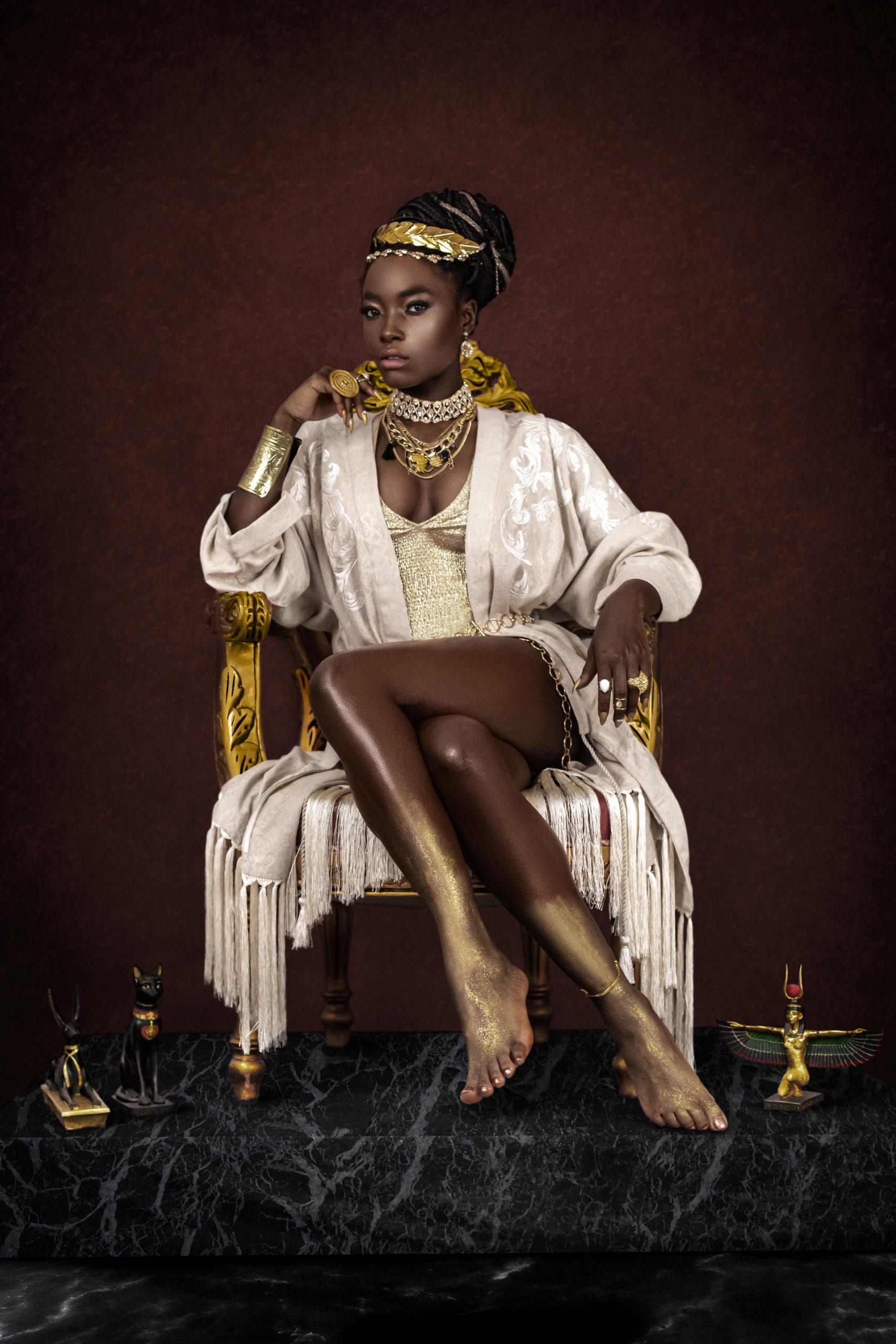 Female Egyptian Pharaoh Sitting On Gold Throne