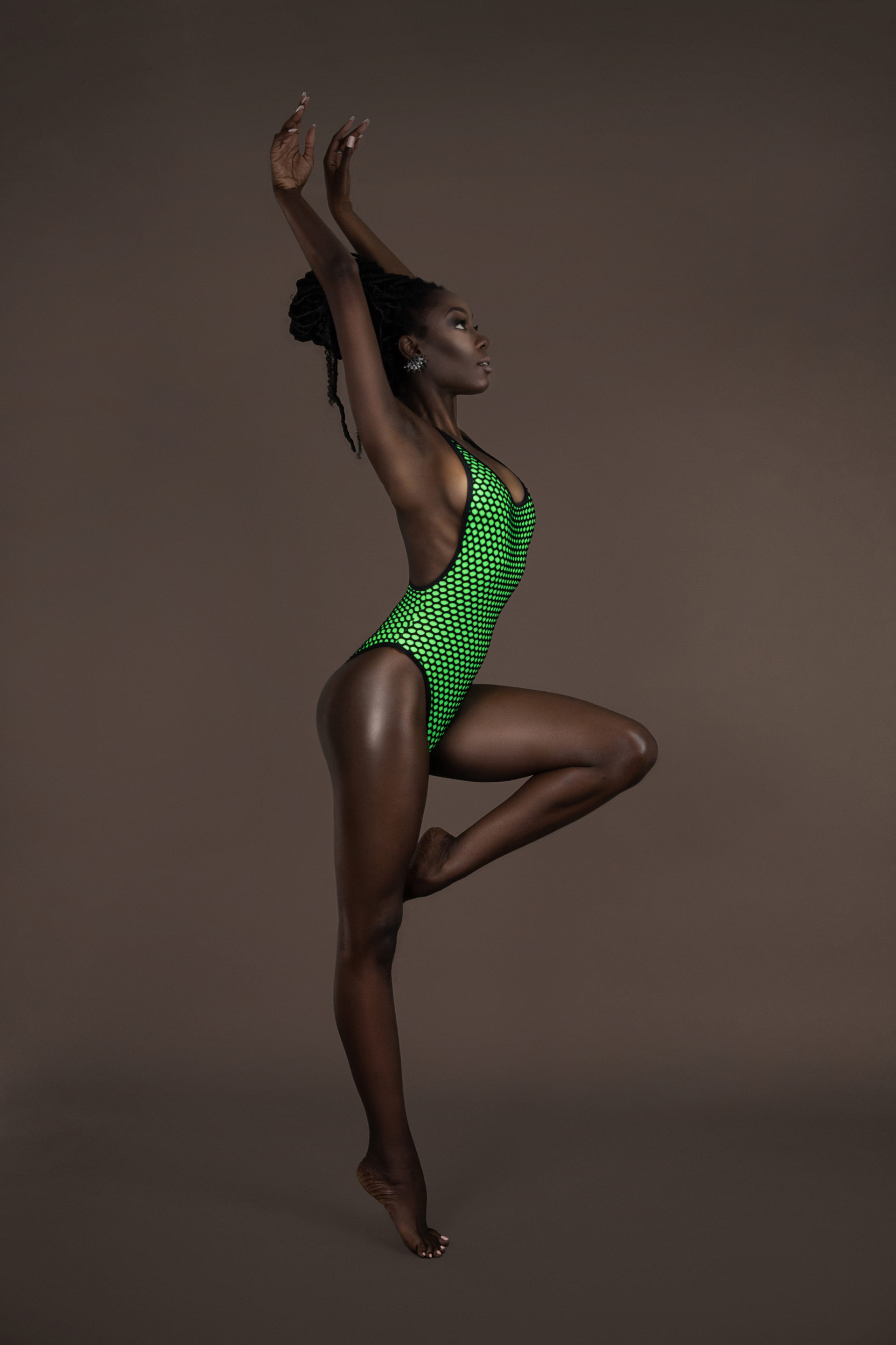 Dancing Black Lady In Green Bathing Suit