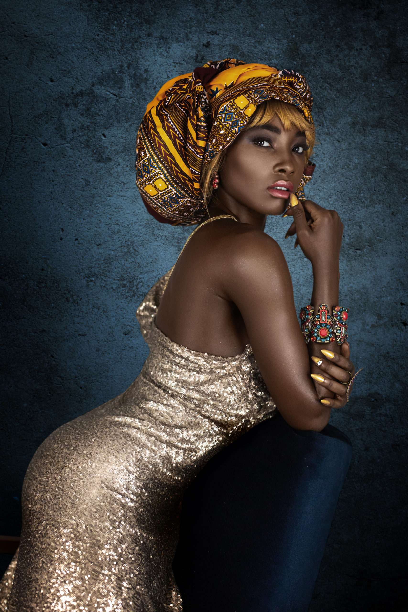 Female Egyptian Wearing a Golden Dress & Colorful Headwrap