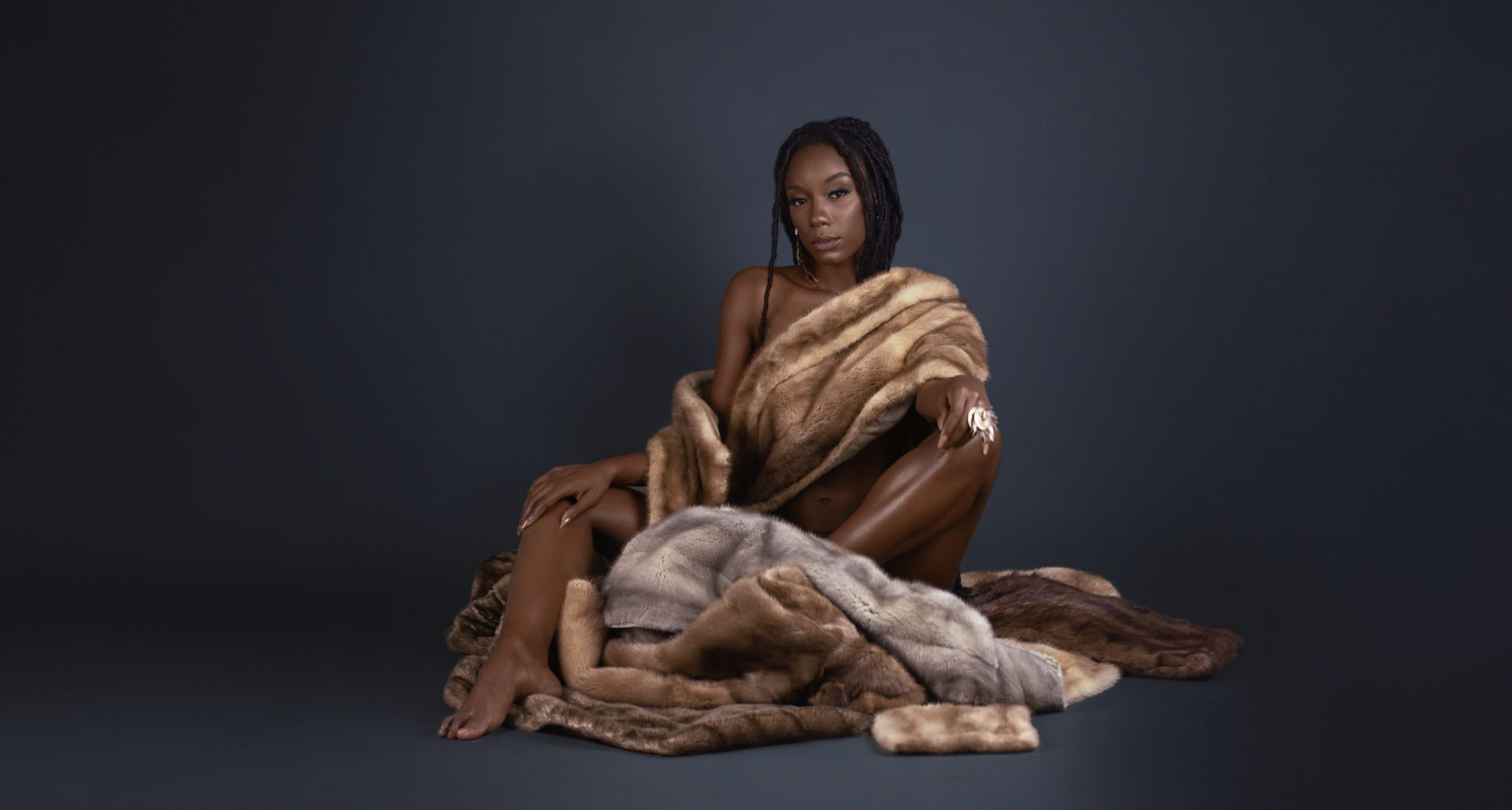 Sensual Young Black Lady Sitting in Fur