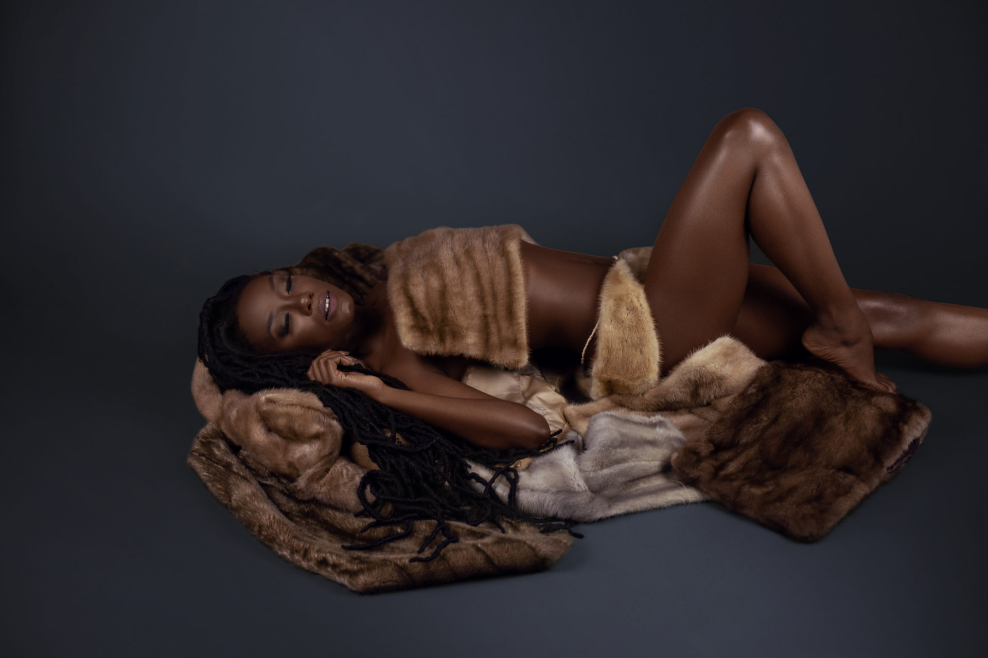 Sensual Young Black Lady Laying on Fur