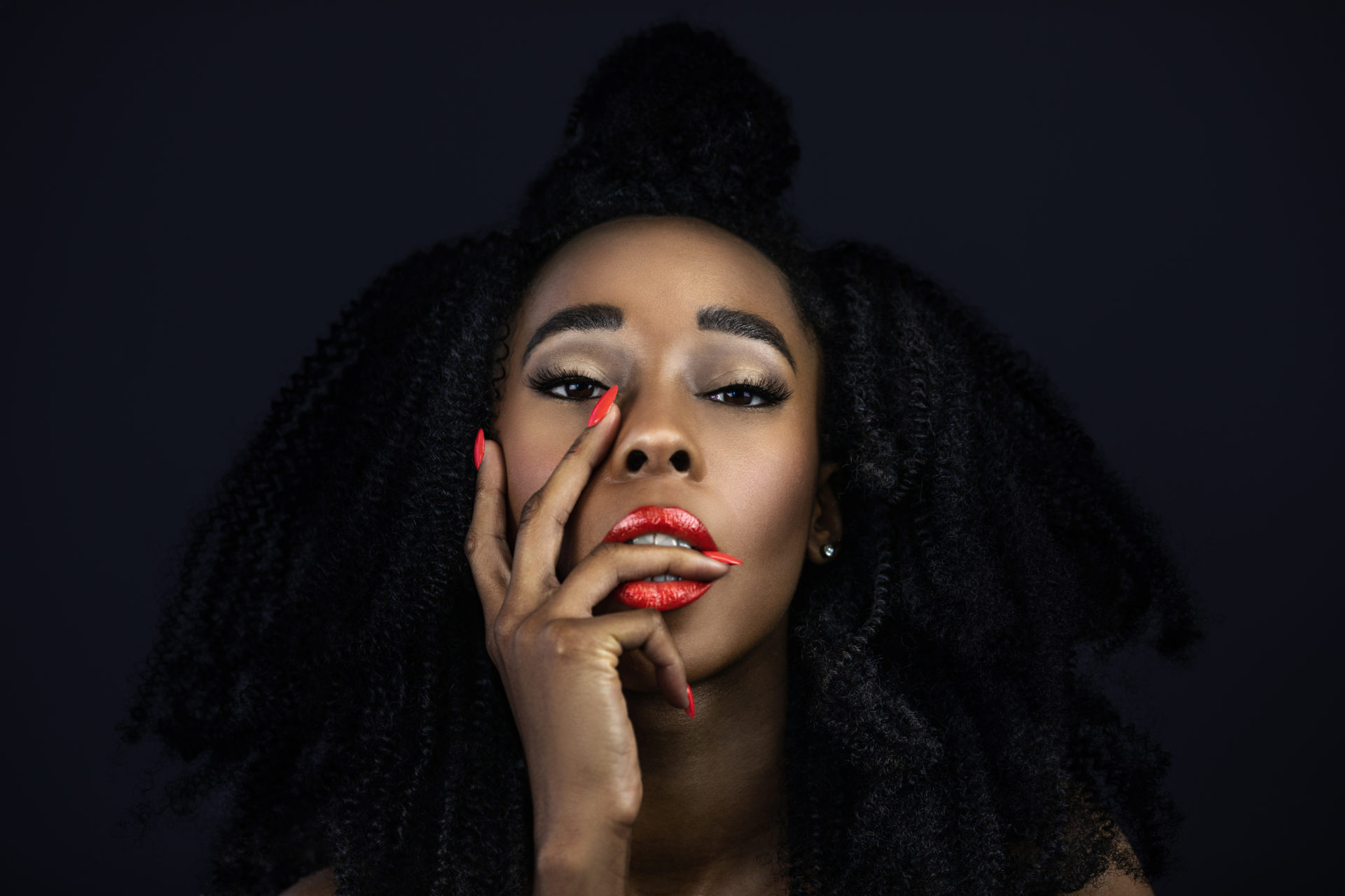Curly Sensual Black Lady with Red Lipstick & Nails