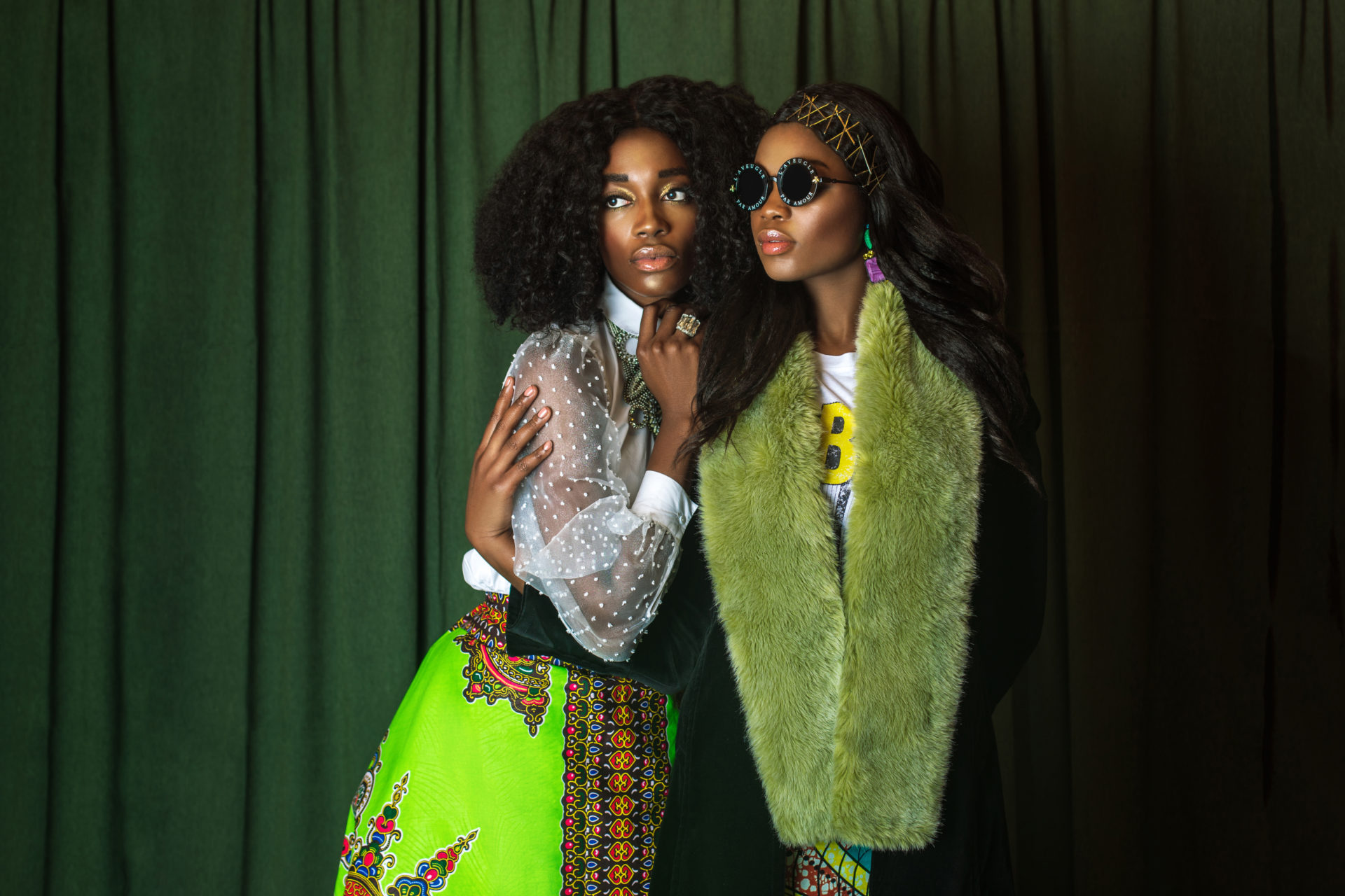 Two Serene Black Ladies in African Designer Clothing