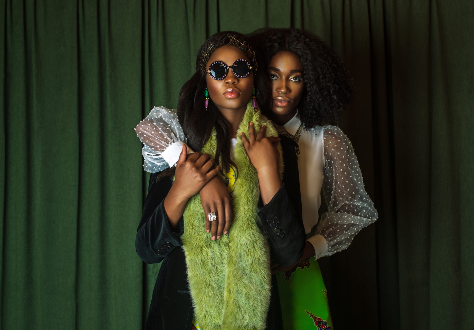 Two Attractive Black Ladies in African Designer Clothing