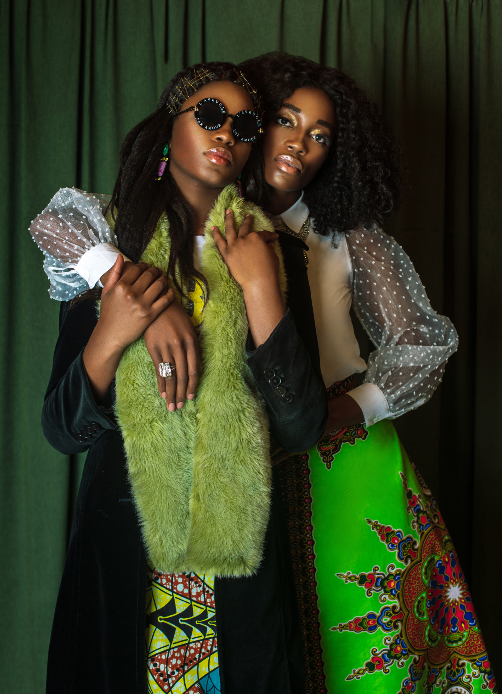 Two Sensual Black Ladies in African Designer Clothing