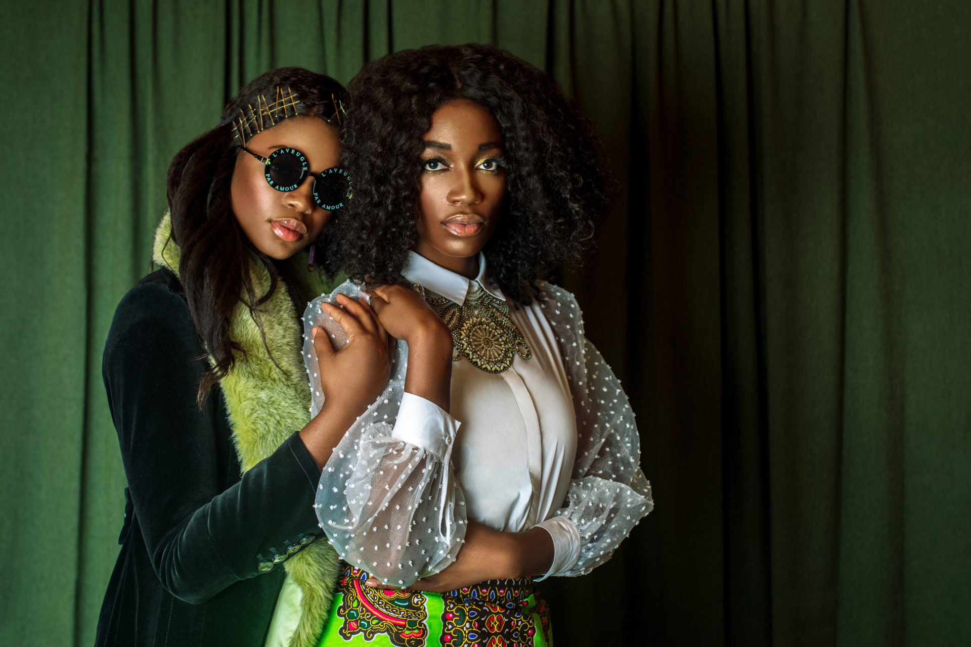 Two Beautiful Black Ladies in African Designer Clothing