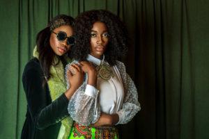 Two Beautiful Black Ladies in African Designer Clothing