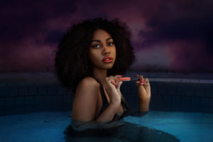 Curly Hair Sensual Shady Lady In The Pool Holding Lip Stick