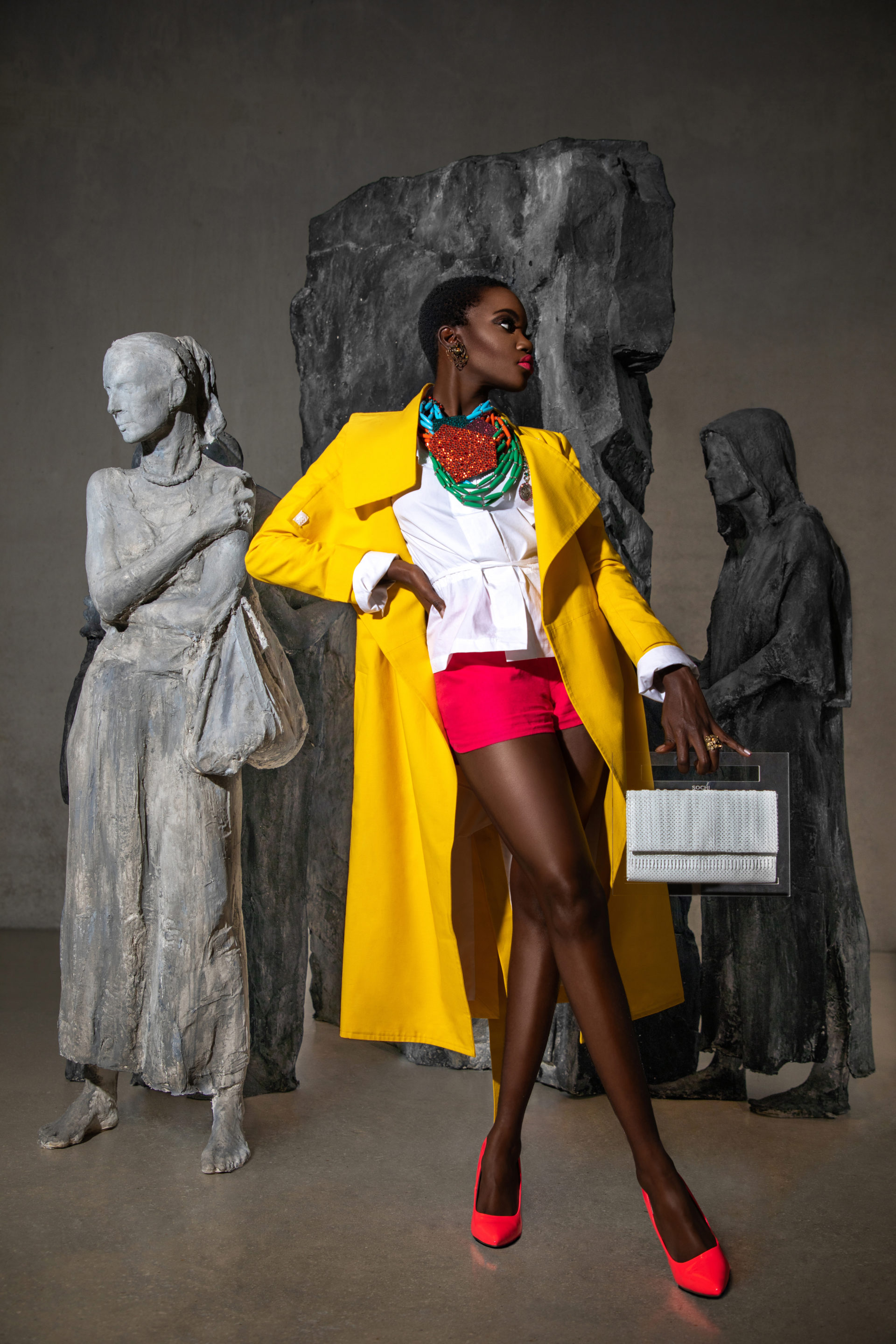 Sexy Young Black Woman In Yellow Coat at Perez Museum
