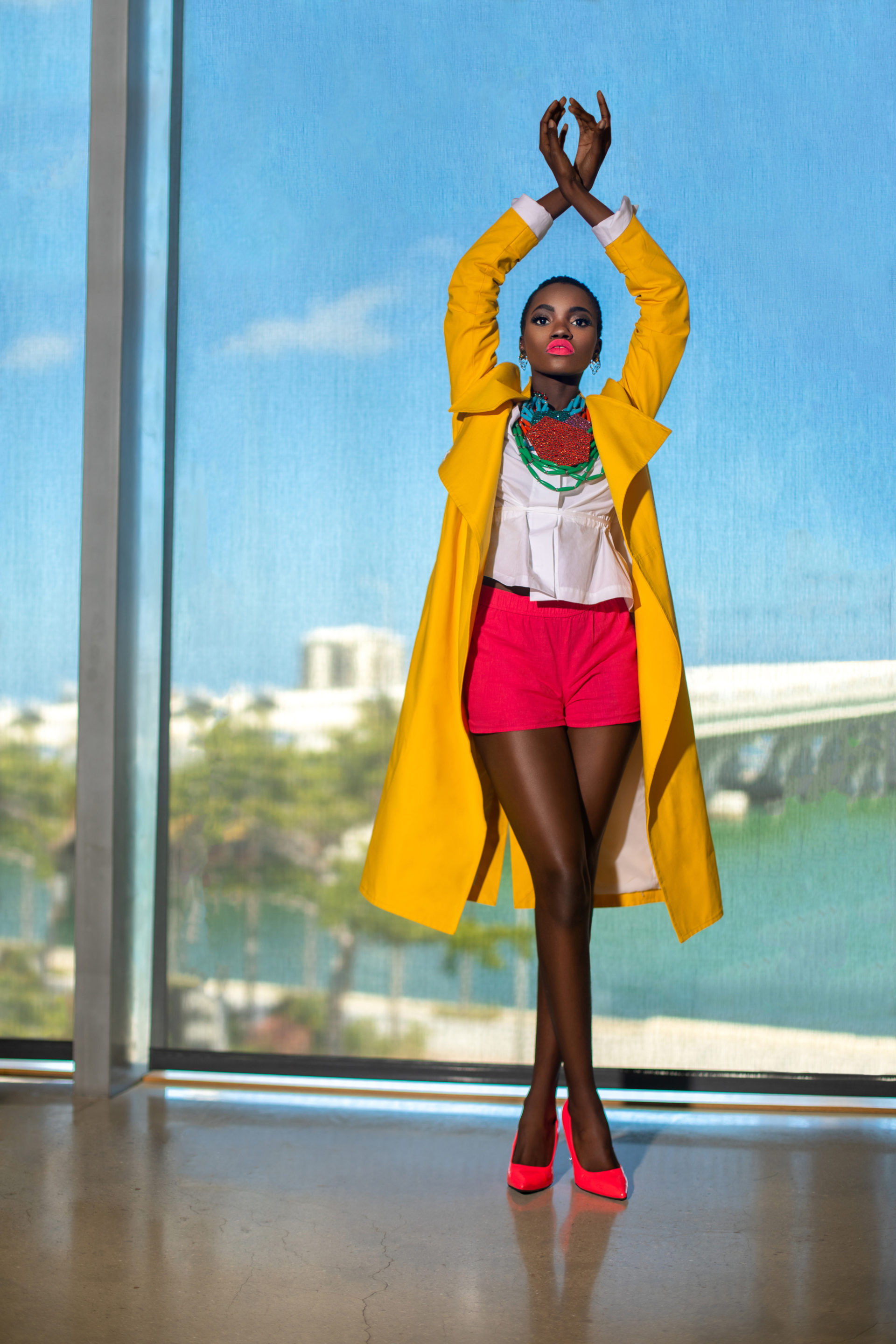 Young Black Woman In Yellow Coat at Perez Museum