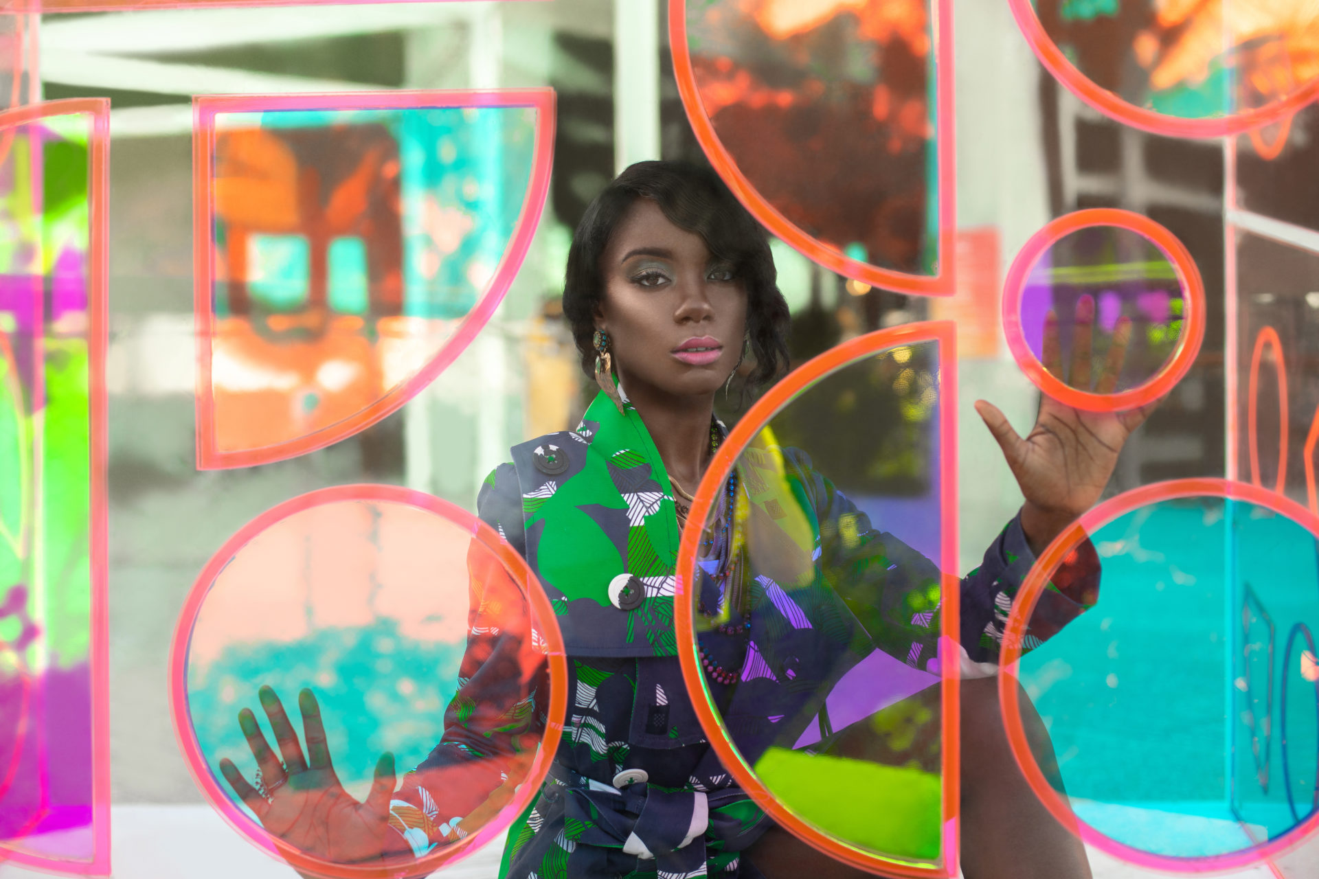 Closeup Young Black Woman In Green Dress Behind Glass