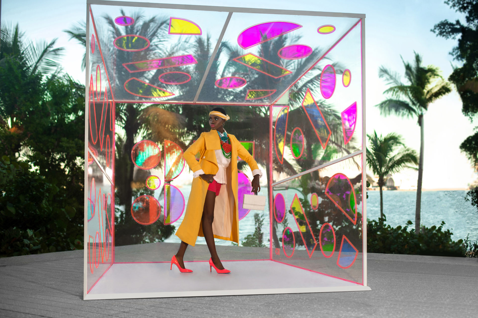 Young Black Woman In Yellow Coat in Glass Box