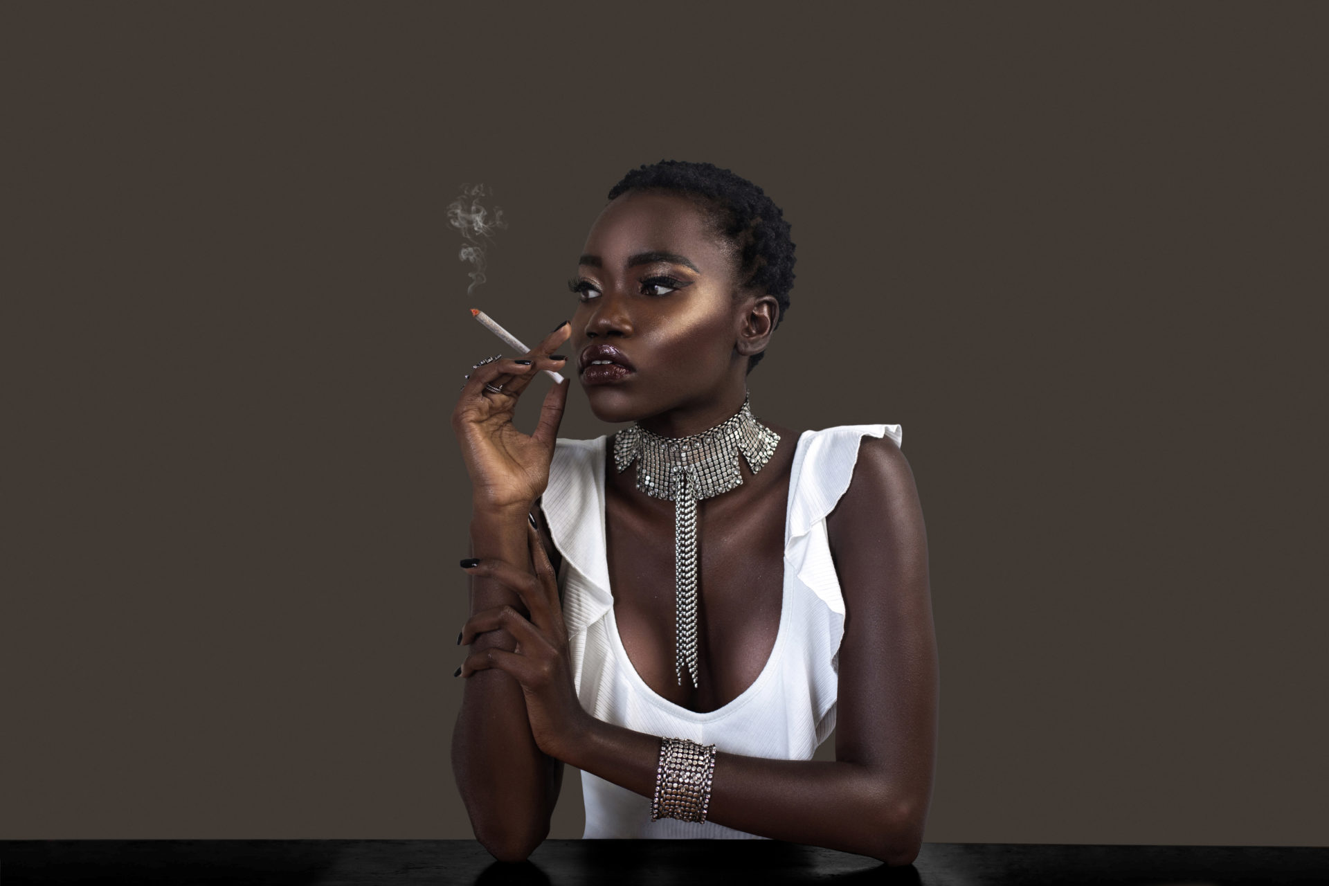 Joint Smoking Black Lady in Silver Jewelry