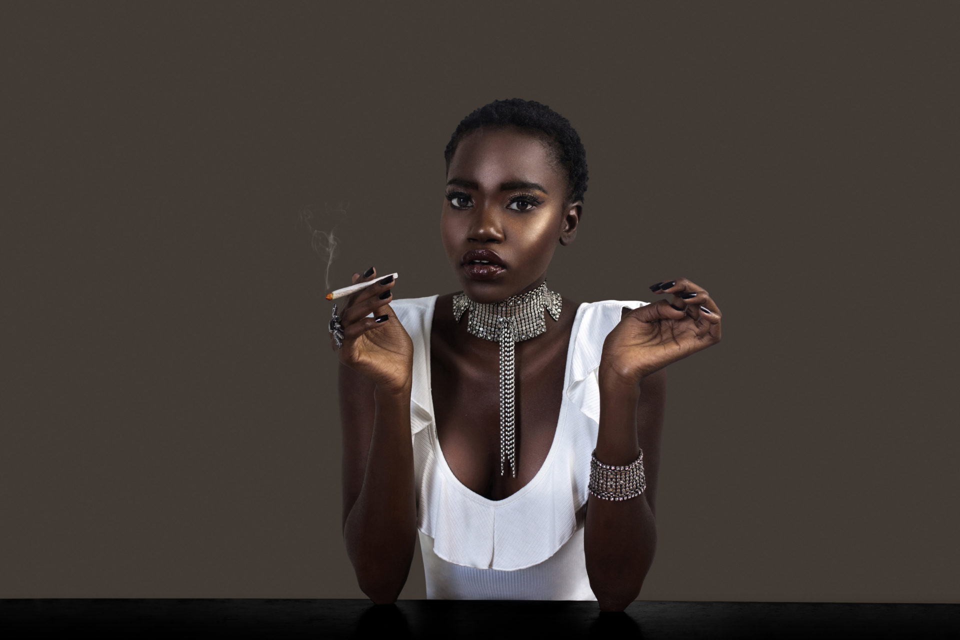 Joint Smoking Sophisticated Black Lady in Silver Jewelry