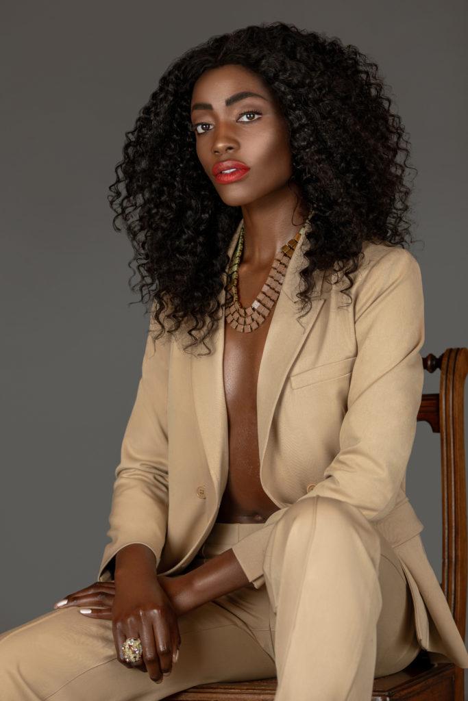 Sexy Black Woman in a Beige Suit