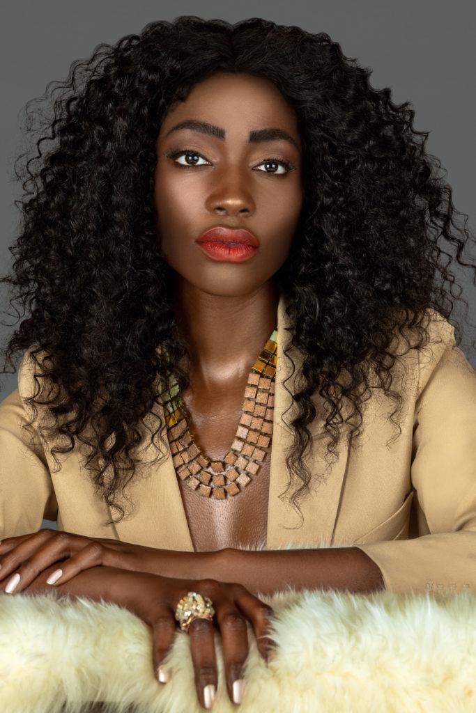 Black Woman in a Beige Suit On Fur