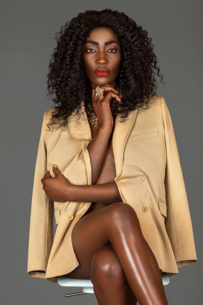 Attractive Black Woman in a Beige Suit