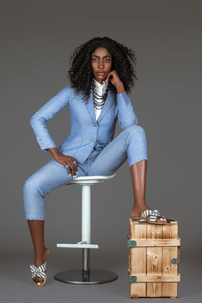 Sexy Black Woman in Blue Suit Sitting